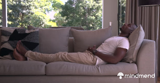 Relaxing on the couch after taking Mind Mend microdosing product.
